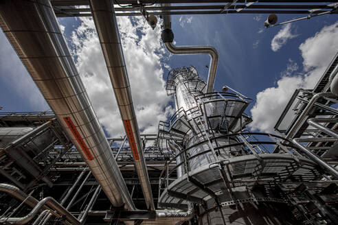 Natural gas processing plant structures with blue sky - CAVF85444