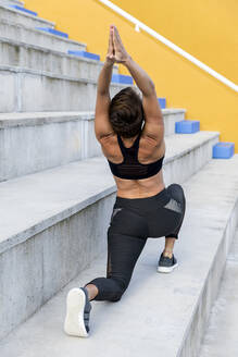 Athletic woman during workout on stairs - LVVF00092