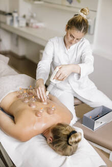 Cupping therapy, treatment at back - DAWF01704