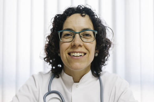 Smiling mature female doctor at medical clinic - XLGF00254