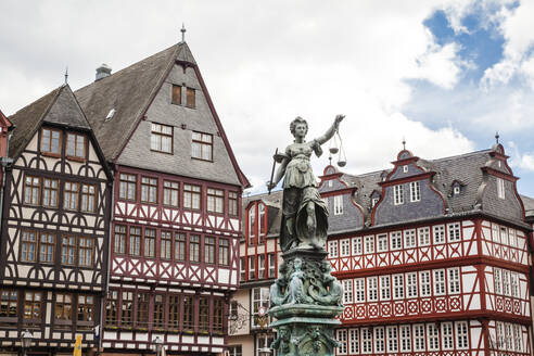 Germany, Frankfurt, Old buildings and statue on Romerberg square - FLMF00256