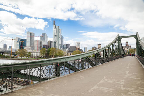 Germany, Frankfurt, Downtown skyscrapers seen from bridge on Main river - FLMF00259