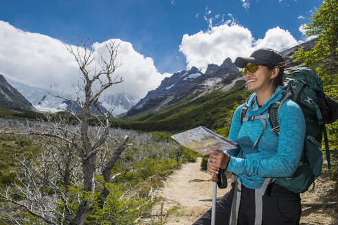 Woman hiking in the Andes mountain range towards Cerro Torre - CAVF86191