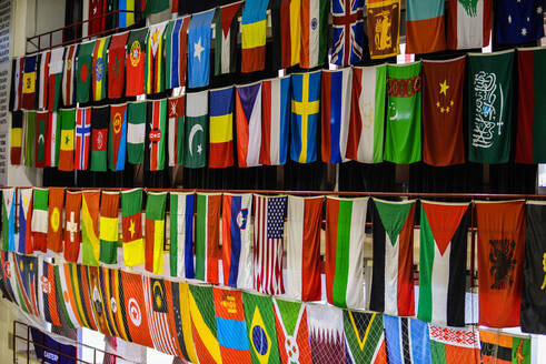 Full Frame Shot Of Multi Colored Flags Hanging At Store - EYF08497