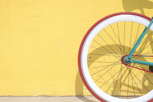 Close-Up Of Bicycle Parked By Yellow Wall - EYF08742