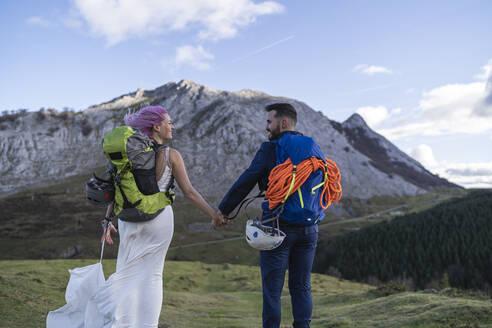 Bridal couple with climbing backpacks at Urkiola mountain, Spain - SNF00385
