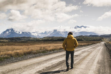 Man looking at snowcapped mountain against sky at Patagonia, Argentina - UUF20731