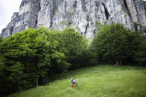 Hiker walking on mountain path, Orobie, European Alps, Como, Italy - MCVF00481