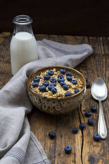 Milk bottle and bowl of granola with blueberries and quinoa - LVF08946