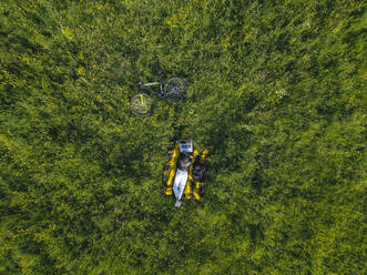 Aerial view of young woman at the green lawn, Tikhvin, Russia - KNTF04733