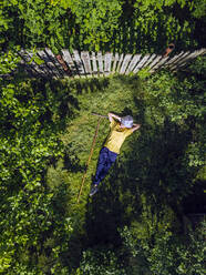 Aerial view of woman resting at garden, Tikhvin, Russia - KNTF04745