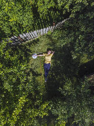 Aerial view of woman resting at garden, Tikhvin, Russia - KNTF04748