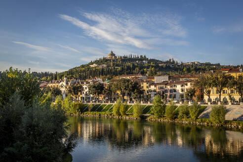 Italy, Veneto, Verona, City houses along Adige river in summer - NGF00561