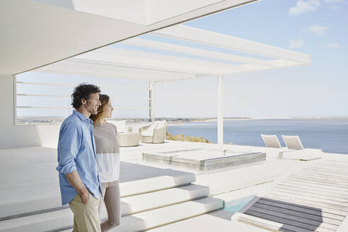 Couple at luxury beach house enjoying the view - RORF02248
