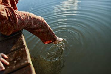 Serbia, Curug, Woman, Lake, Touching water - ZEDF03605
