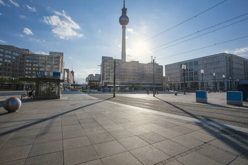 Germany, Berlin, Sun shining over empty Alexanderplatz during COVID-19 pandemic - ZMF00499