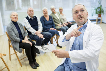 Group of seniors attending health counselling in retirement home - WESTF24589