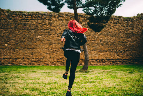Stylish girl on old stone alley - ADSF00435
