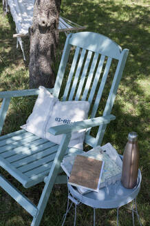 Deck chair, pillow sewn from cotton sack, steel water bottle, map, note pad and table made of tray and lamp shade - GISF00624