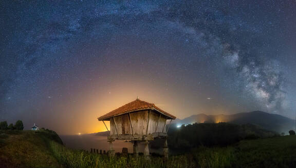 Long exposure shot of beautiful starry sky over small shack in Asturias, Spain - ADSF00728