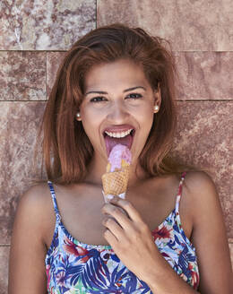 Young woman eating icecream - PGCF00098