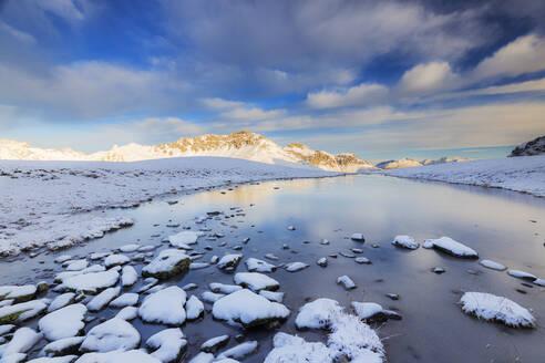Winter scenery with frozen alpine lake, Stelvio Pass, Valtellina, Lombardy, Italy, Europe - RHPLF15580