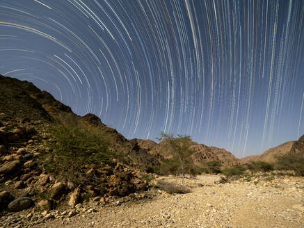 Star trails at night in Wadi Al Arbeen, Sultanate of Oman, Middle East - RHPLF15877