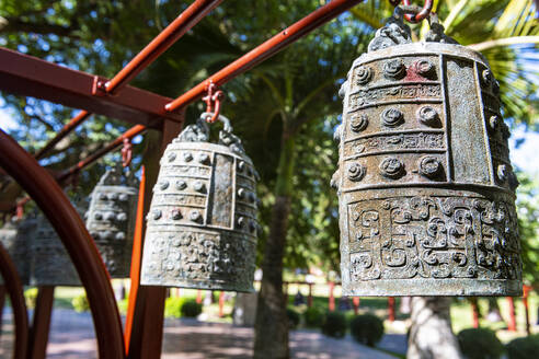 China, Hainan, Sanya, Large ornate bells inside Nanshan Temple - RUNF03839