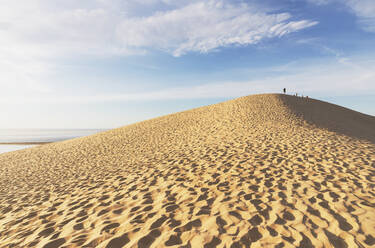 Scenic view of Pilat dunes against sky during sunny day, Dune of Pilat, Nouvelle-Aquitaine, France - GWF06635
