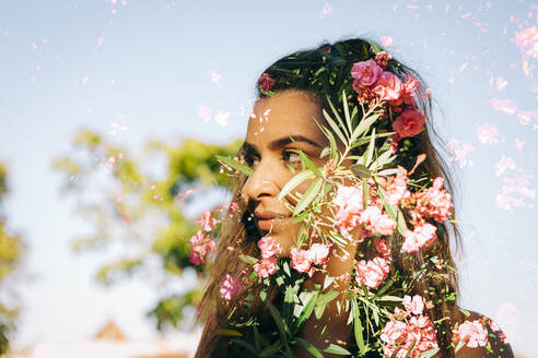 Double exposure of thoughtful young woman and flowers against clear sky - DCRF00470
