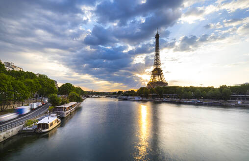 Eiffel Tower by Seine river against blue sky during sunrise, Paris, France - HSIF00783