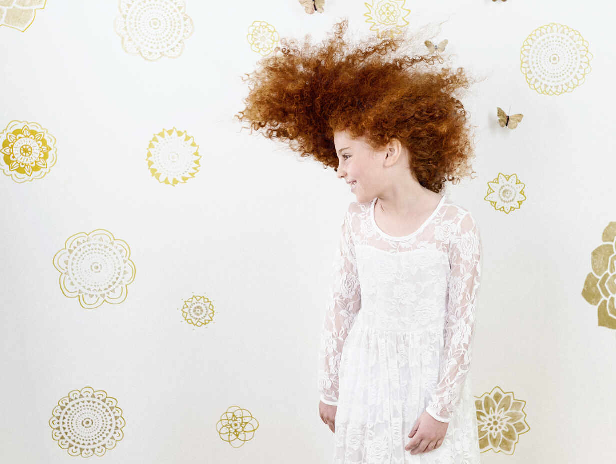 Portrait Carefree Girl With Curly Red Hair Against Pattern Backdrop Fsif05122 Tamara Lackey Westend61