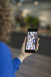 Friends video chatting on smart phone screen - CAIF28745