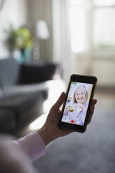 Senior women friends video chatting on smart phone screen - CAIF28748