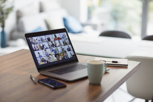 Colleagues video conferencing on laptop screen - CAIF28766