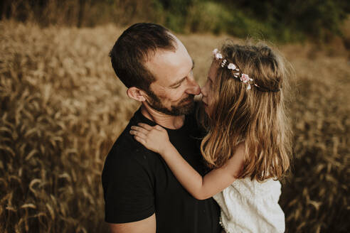 Father and daughter making wonderful memories together in wheat farm - GMLF00346