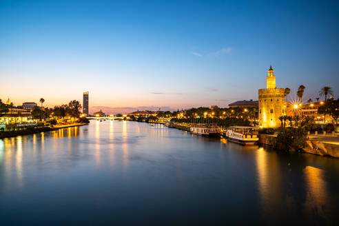 Sunset at Torre del Oro (Tower of Gold), a watchtower on the bank of the Guadalquivir River in Seville, Andalusia, Spain, Europe - RHPLF16272