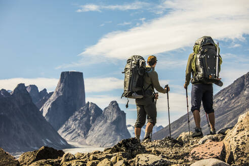 Two Backpackers look out at view from mountain ridge. - CAVF87632
