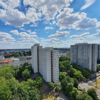 Germany, Berlin, Clouds over apartment buildings in Mitteborough - NGF00592