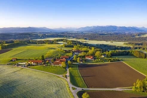 Germany, Bavaria, Rampertshofen, Drone view of countryside village in summer - LHF00818