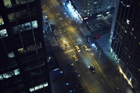From above of street with vehicles driving among high rise buildings in center of New York city - ADSF09211