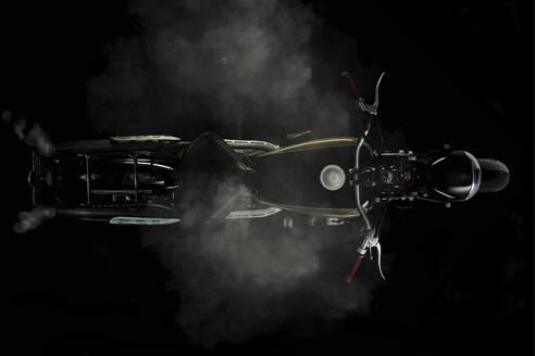 Top view of vintage motorcycle with smoke and black background (Ardie RZ 200 Peter) - SRSF00654
