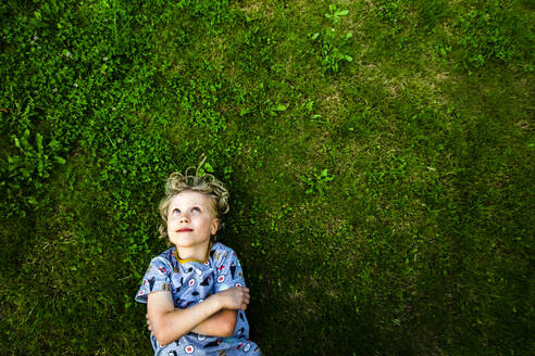 A 6-year old boy laying on the grass, Hamburg, Germany - IHF00377