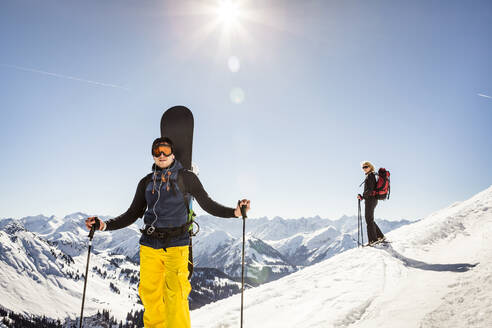 Man ski touring up to a mountain peak, Achenkirch, Austria - DHEF00248