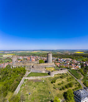 Germany, Hesse, Munzenberg, Helicopter view of Munzenberg Castle and surrounding village in summer - AMF08380
