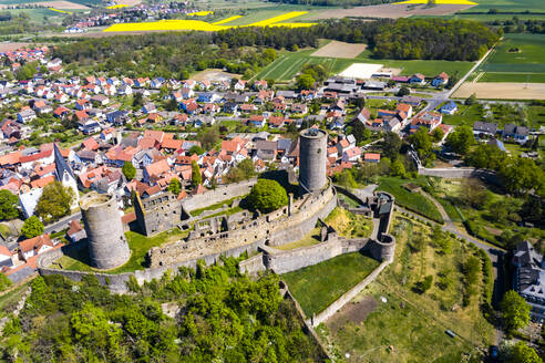 Germany, Hesse, Munzenberg, Helicopter view of Munzenberg Castle and surrounding village in summer - AMF08386