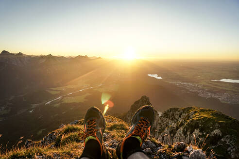 HIking shoes of hiker on viewpoint during sunset, Saeuling, Bavaria, Germany - MALF00056