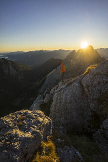 Rear view of female hiker on viewpoint during sunrise, Gimpel, Tyrol, Austria - MALF00062