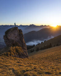 Hiker on viewpoint during sunset, Aggenstein, Bavaria, Germany - MALF00065