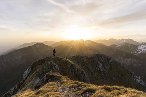 Female hiker during sunset, Saeuling, Bavaria, Germany - MALF00068